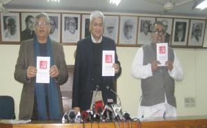 Prakash Karat, Sitaram Yechury and K.Varadharajan releasing the draft political resolution for the 21st Congress.